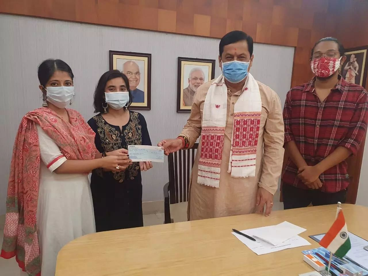 Assam students body donates money for flood relief to CM Sonowal, lauded