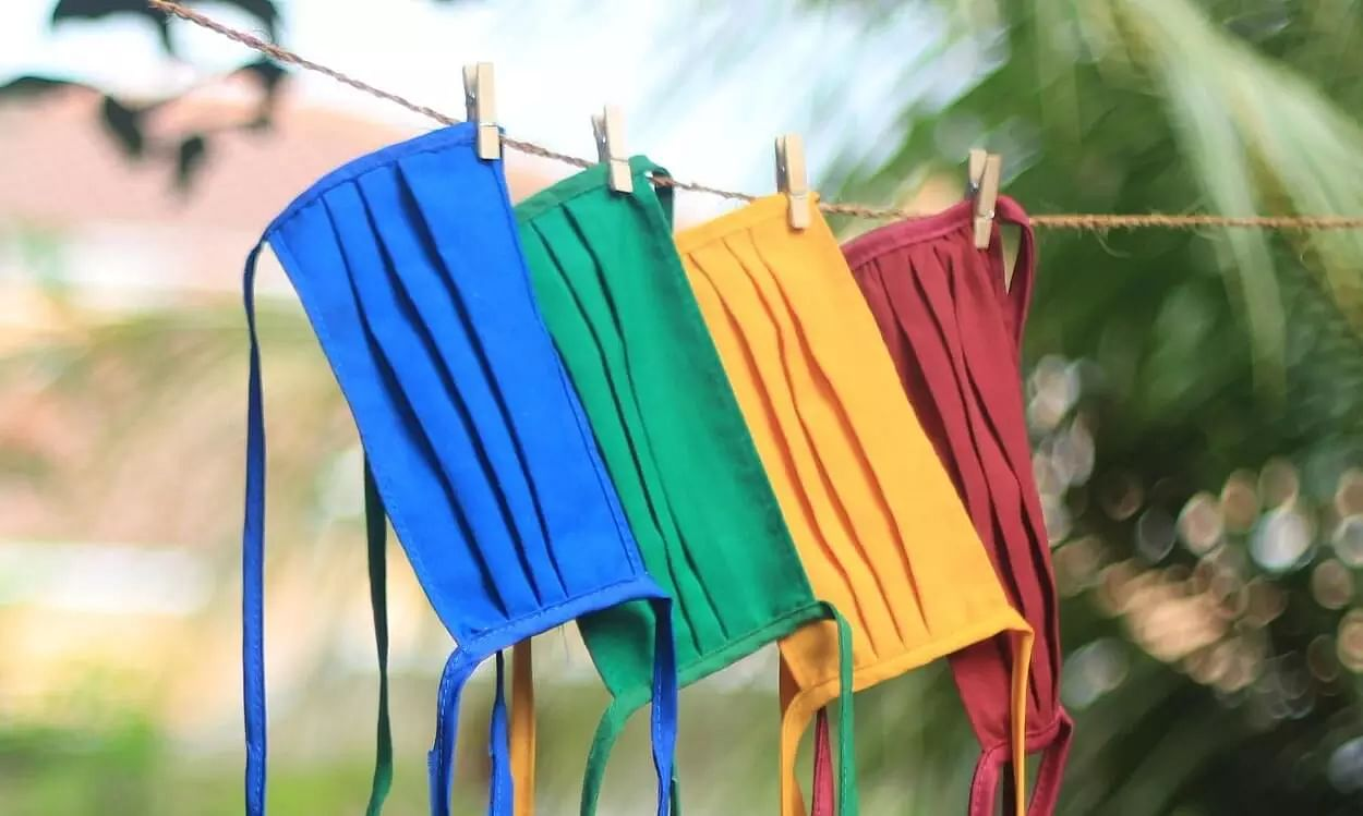 Cloth masks if washed at high temperature reduce transmission of COVID-19: Study