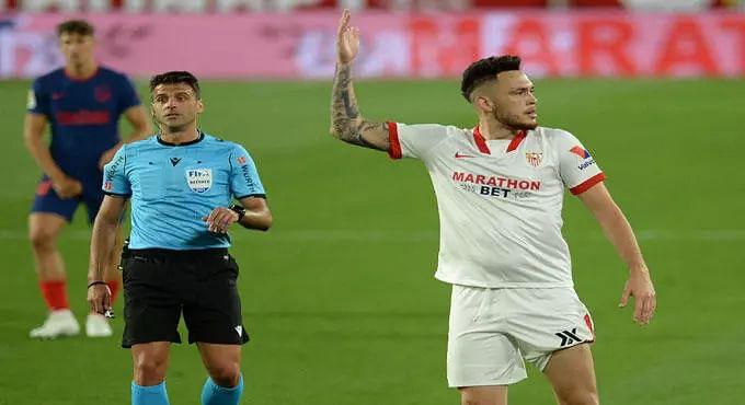 Atletico Madrid lose to Sevilla, leave La Liga title race open