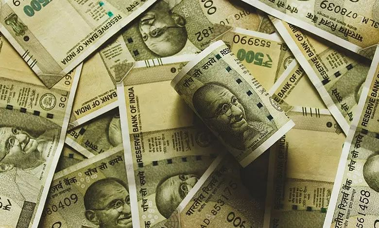 Rupee slips on RBIs dovish stance, loose policy