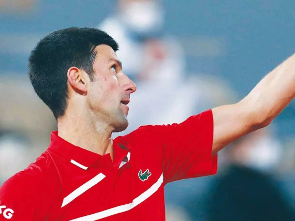 Novak Djokovic wins but loses cool in rain-marred match