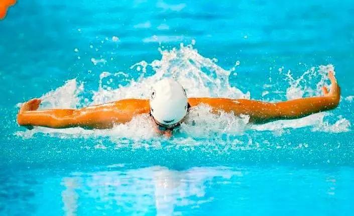 Olympic swim stars enter quarantine on return to Australia